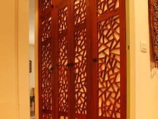 Custom made doors for a dressing: Dressing de style  par Matahati