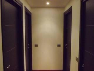 Ristrutturazione interna di appartamento - Grosseto Ingresso, Corridoio & Scale in stile moderno di Studio Tecnico Associato FGS Project Moderno
