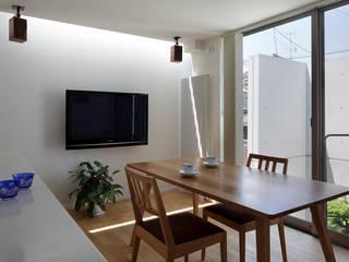 Modern dining room by 長浜信幸建築設計事務所 Modern