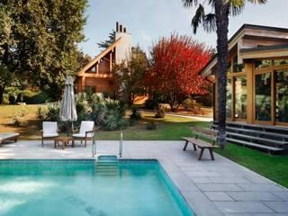 casa in legno: Case in stile in stile Moderno di alberico & giachetti architetti associati