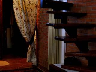 Rustic style corridor, hallway & stairs by Studio di Progettazione Arch. Tiziana Franchina Rustic