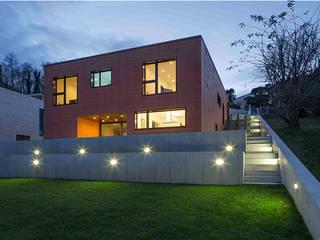 casa MGP: Case in stile  di Teamwork architetti_arch. Nicola Pasteris