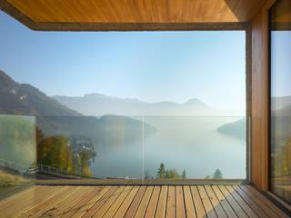 Ferienhaus Huse Vitznau Moderne Fenster & Türen von alp - architektur lischer partner ag Modern