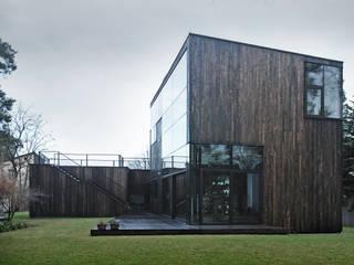 DOM POD DĘBEM Minimalistyczne domy od SDA - SZCZEŚNIAK DENIER ARCHITEKCI Minimalistyczny