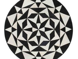WovenGround Ambition round rug, hand made:   by WovenGround