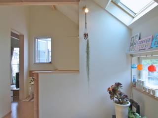 大きなお庭の2世帯住宅: ジェイ石田アソシエイツが手掛けたサンルームです。