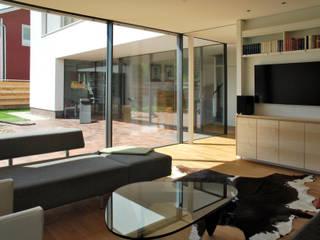NW13 - Wohnhaus am Park Moderne Wohnzimmer von JÖRN KNOP ARCHITEKt+INNENARCHITEKT Modern