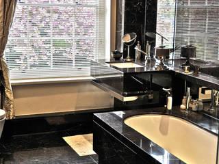 Baños de estilo  de Ogle luxury Kitchens & Bathrooms, Moderno