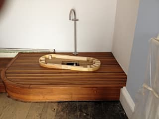 Copper bateau bath with riva teak platform design and installation in Tenby by Pembroke Bathrooms