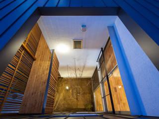 岸和田の家 中庭: 神谷徹建築設計事務所が手掛けた庭です。