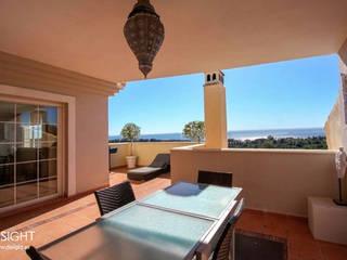terraza comedor vistas al mar Balcones y terrazas de estilo moderno de DISIGHT Moderno