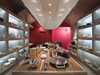 Acqua & Fuoco - retail &food - Piacenza 2008 Spazi commerciali in stile industrial di Brizzi+Riefenstahl Studio Industrial