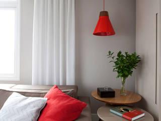 Apartamento Bossa: Salas de estar  por Juliana Pippi Arquitetura & Design
