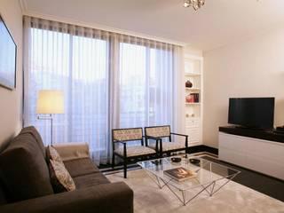 Apartamento c/ 1 quarto - Praça da Espanha, Lisboa: Salas de estar  por Traço Magenta - Design de Interiores