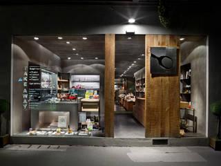 Oficinas y tiendas de estilo industrial de Brizzi+Riefenstahl Studio Industrial