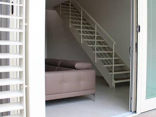 Dittongo architetti Puertas y ventanas de estilo moderno