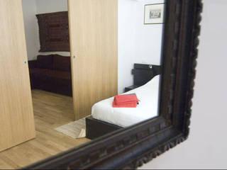 Dormitorios de estilo  de Studio Racheli Architetti, Moderno