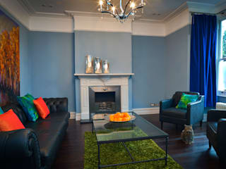 A Masculine Living Room with Vivid Accents Modern living room by Cathy Phillips & Co Modern