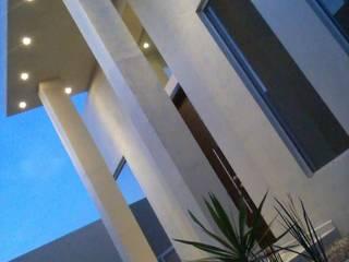 Casa Minimalista Espacios comerciales de estilo minimalista de Guiza Construcciones Minimalista