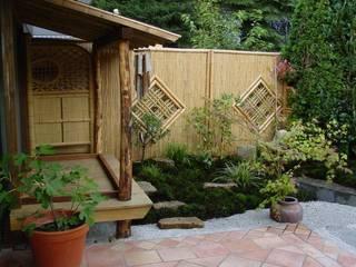 Jardines de estilo asiático por Kokeniwa Japanische Gartengestaltung