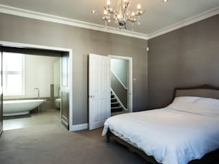Master bedroom with ensuite bathroom Modern style bedroom by Affleck Property Services Modern