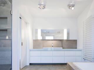 Baños de estilo  por Skandella Architektur Innenarchitektur