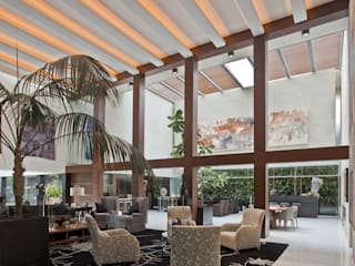 Casa H: Salas de estilo  por Cm2 Management