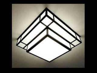 Réalisation des luminaires pour un ensemble d'habitation à Paris quartier Opéra par Raphaël Armand Luminaires Moderne