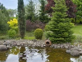 Ogród w okolicach Skierniewic - 3,5 tys. m2 Śródziemnomorski ogród od Pink Pug Design Interior Śródziemnomorski