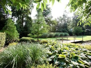 Landschappelijke natuurrijke onderhoudsvriendelijke tuin Holland- Landscape nature rich maintenance friendly garden in the Netherlands. : country Garden by FLORERA , design and realisation gardens and other outdoor spaces.