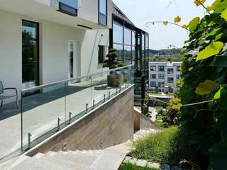 Casas de estilo  de ARCHITEKT.LEMANSKI