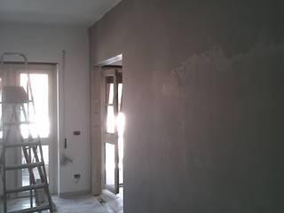 Progetto di interni per un appartamento di una giovane coppia - Roma, Via Val di Non Roberta Rose Pareti & PavimentiVernici & Smalti