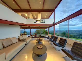 Projekty,  Salon zaprojektowane przez Denise Macedo Arquitetos Associados,