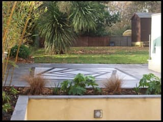 Garden design with tricky levels by Westacott Gardens