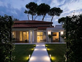 Eclectic style houses by Studio Architettura Carlo Ceresoli Eclectic