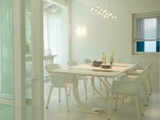 Sala de jantar  por Studio Architettura Carlo Ceresoli