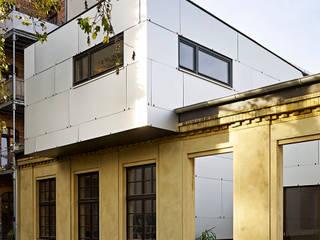 Siemeringstraße - ein Haus im Haus Industriale Häuser von quartier vier Architekten Landschaftsarchitekten Industrial