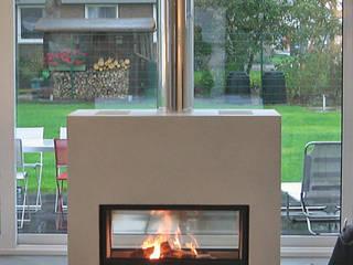 STRICK Architekten + Ingenieure Living roomFireplaces & accessories