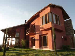 Casas rústicas de Mascarenhas Arquitetos Associados Rústico