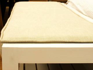 Un dormitorio blanco con lino de Cube Deco Escandinavo