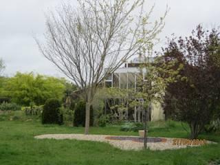 Maison bio-climatique Maisons modernes par Michel BONNEAU Architecte DPLG Moderne