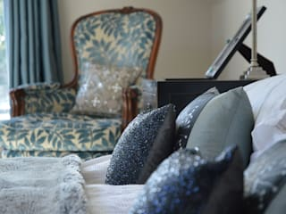 Close  up of bed and chair : modern Bedroom by Zodiac Design