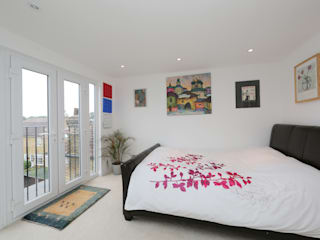 hip to gable loft conversion wimbledon:  Bedroom by nuspace