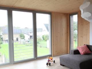 Wohnzimmer: minimalistische Wohnzimmer von unger architekten