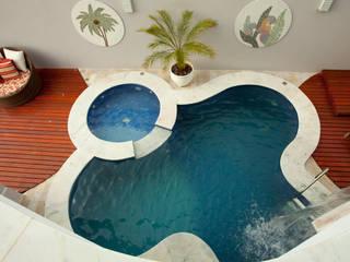 Casa das Águas: Piscinas  por Arquiteto Aquiles Nícolas Kílaris