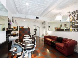 Barbieria Montenero: Negozi & Locali commerciali in stile  di WALTER SBICCA studio