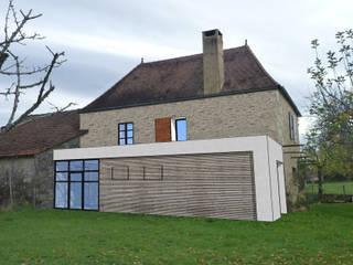 Maison Delchie: Maisons de style  par MAURO LOMBARDO ARCHITECTE