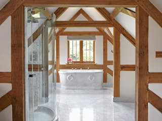 Country House Barn, Surrey من Drummonds Bathrooms بلدي