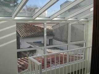 Extension Maison B Balcon, Veranda & Terrasse modernes par FARACHE CLAUDE Moderne