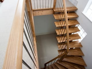 Timber Staircase New Malden por Complete Stair Systems Ltd Moderno